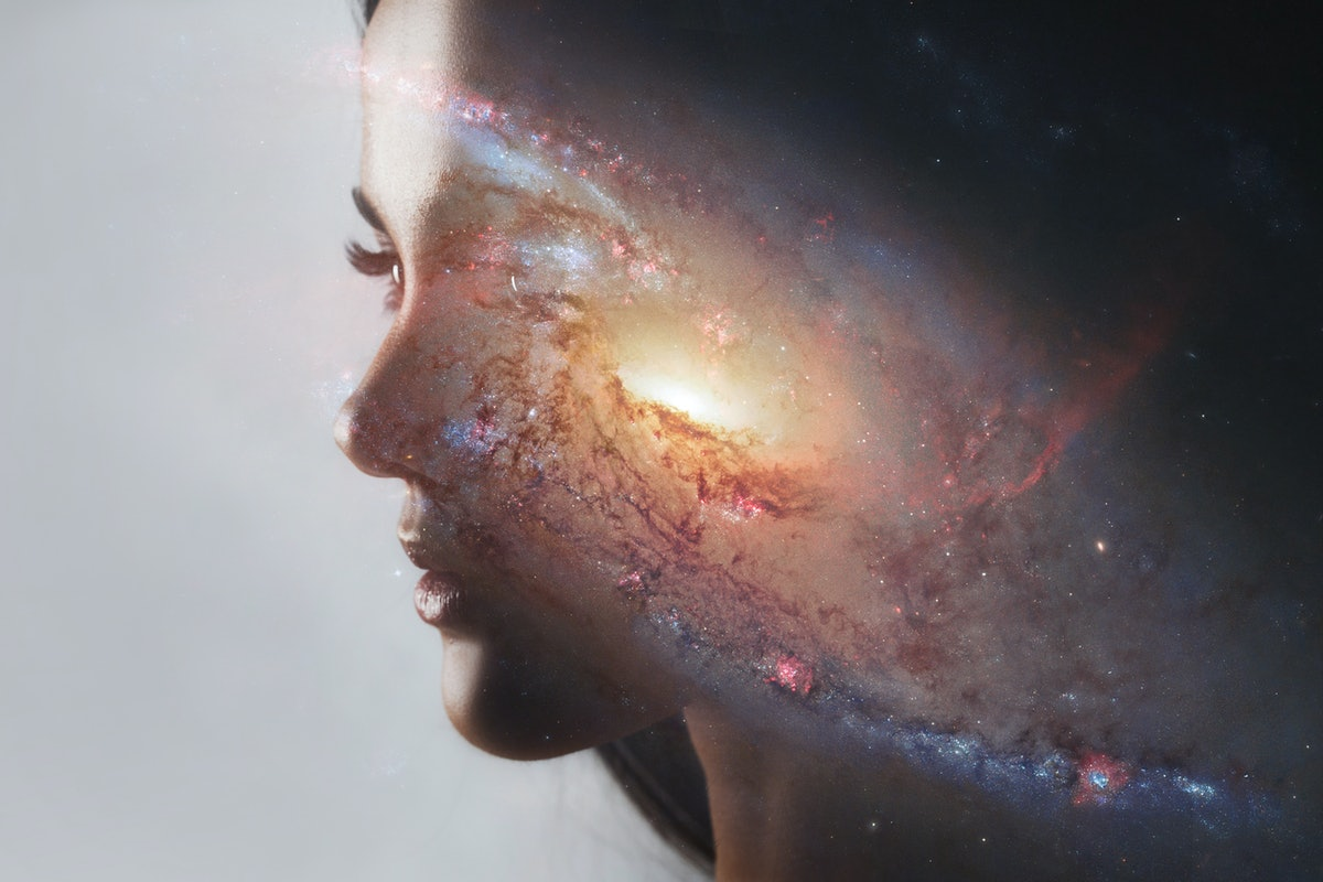 The universe inside us, the profile of a young woman and space, the effect of double exposure. scien...