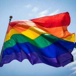 The Rainbow Pride Flag Blows in the Breeze against the Blue Sky over the San Diego LGBT Pride Parade...