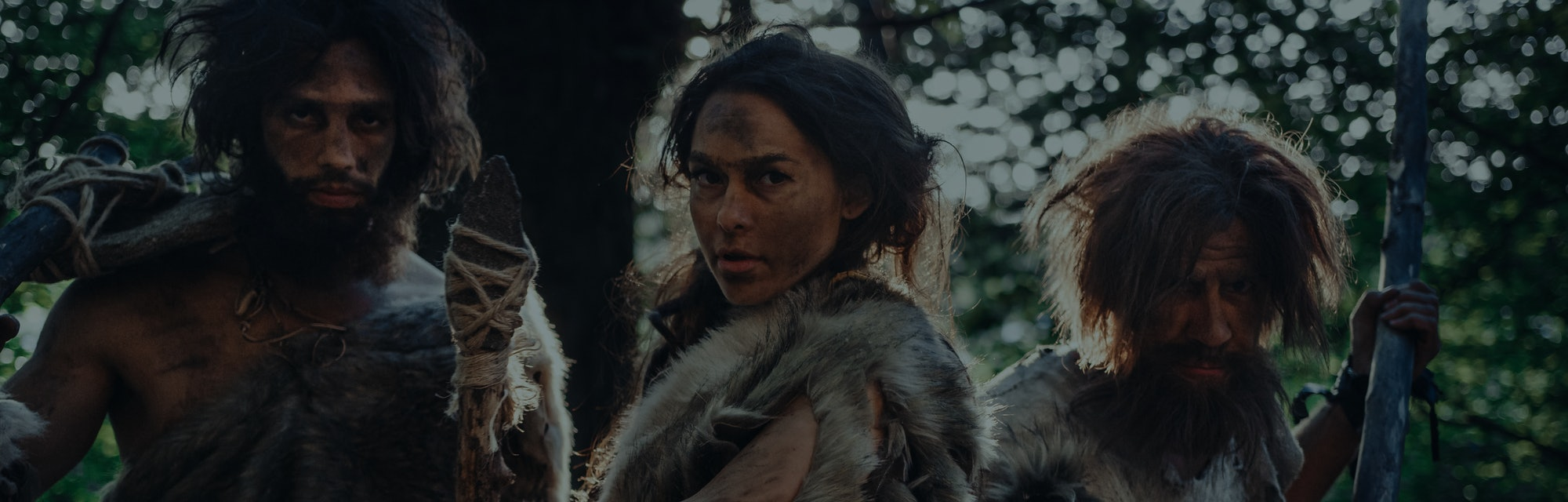Female Leader and Two Primeval Cavemen Warriors Threat Enemy with Stone Tipped Spear, Scream, Defend...