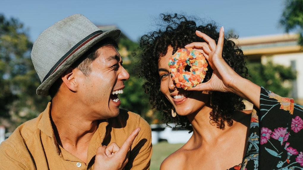 Friends having fun with a doughnut