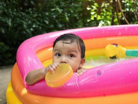 Baby boy in kiddie pool