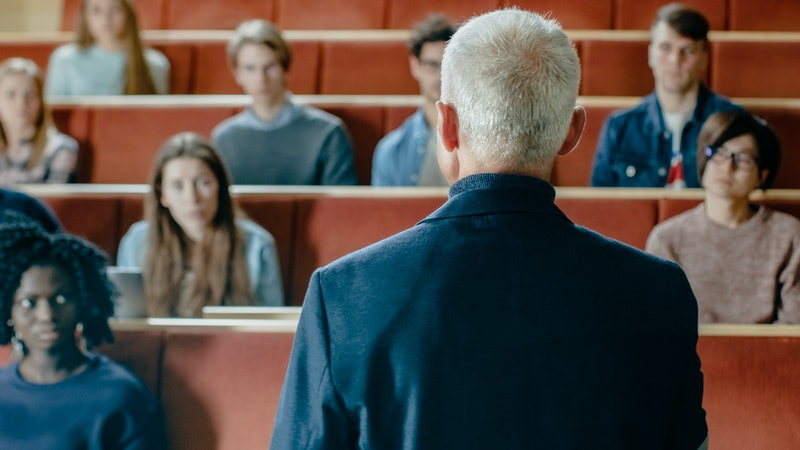 Camera Facing Class: College Professor Gives a Lecture to a Classroom Full of Multi Ethnic Students....