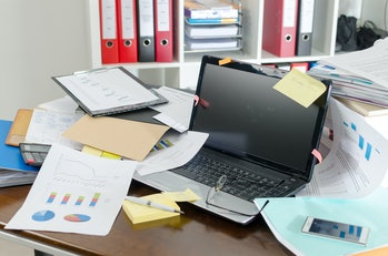 View of a untidy and cluttered desk.