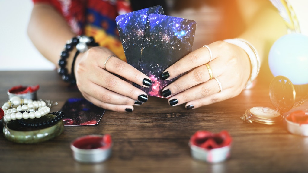 Tarot cards reading divination Psychic readings and clairvoyance concept / Crystal ball fortune teller hands , Magic Spiritual and Horoscopes