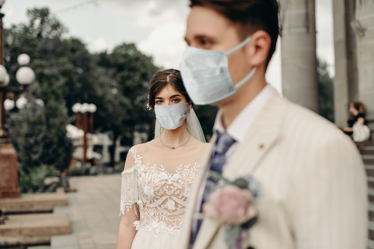When will it be safe to have a wedding again? Experts say large-scale celebrations will have to wait until there's a vaccine.