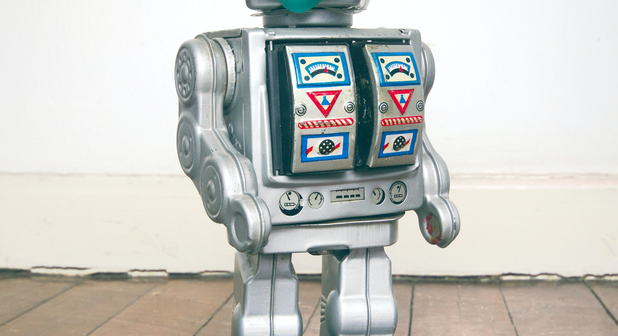 retro robot with text CIVID 19 on a old wooden floor