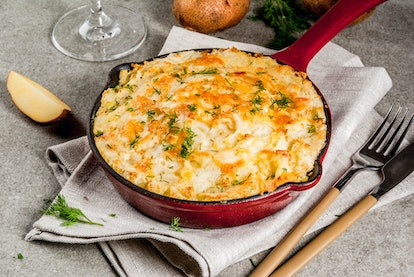 Skillet Shepherd's Pie, british casserole in cast iron pan, with minced meat, mashed potatoes and vegetables, on gray stone background, copy space top view