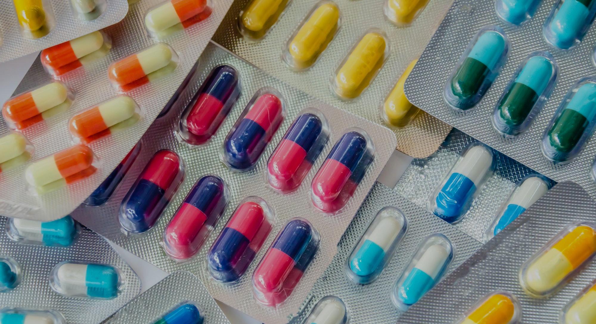 pharmaceuticals antibiotics pills medicine /colorful antibacterials pills on  white background /caps...