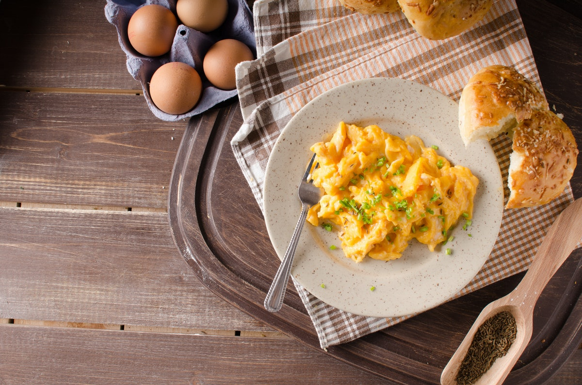 Scrambled eggs with buns, herbs inside, fast and delicious breakfast