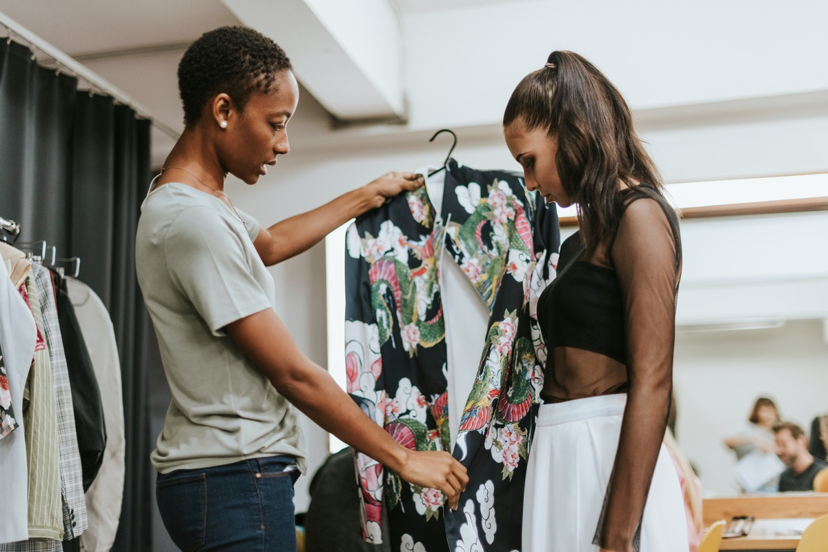 Stylist choosing an outfit for the model