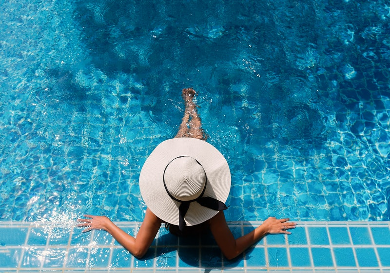 Young asian woman relaxing in swimming pool at spa resort.relaxing concept.