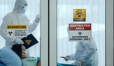 coronavirus covid 19 quarantine and breakout alert sign on window of quarantine room at hospital with coronavirus covid19 disease control experts make disease treatment to coronavirus infected patient