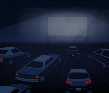Open air, outdoor or drive-in cinema theater at night. Large movie screen glowing in darkness surrou...