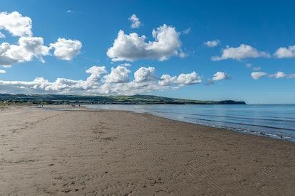 Ayr Beach, Ayrshire, Scotland, United Kingdom, October 2nd 2016. People walk on Ayr beach on a beautiful October day.