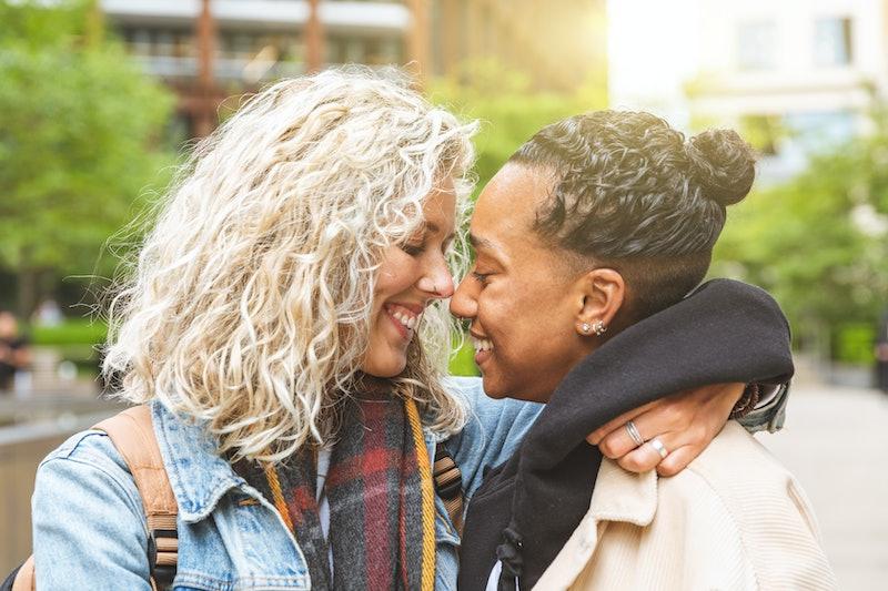 Happy multiracial girlfriends in love embracing and cuddling - Lesbian couple, millennials women, gi...