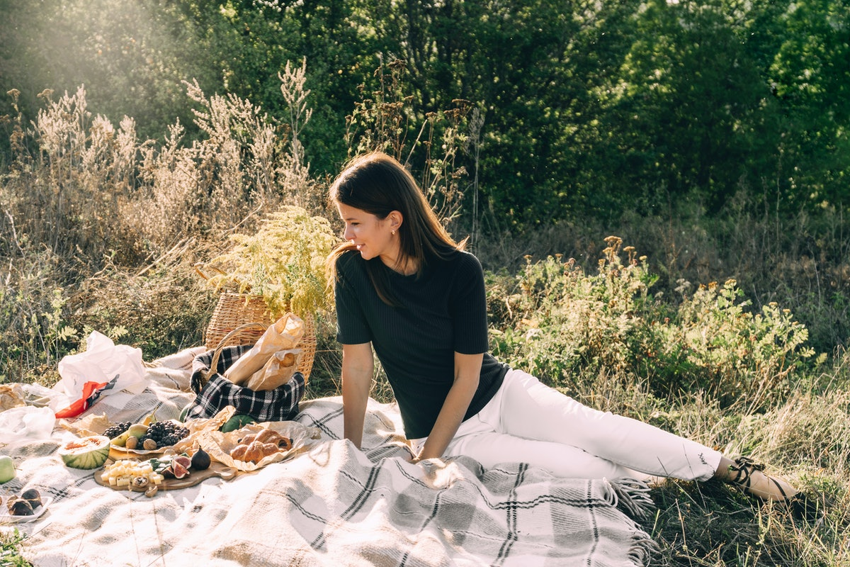 Beautiful young girl on a picnic on a summer day. concept of leisure, vacation, tourism outdoorsy