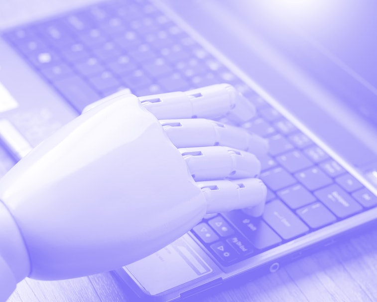 artificial intelligence hand type on keyboard