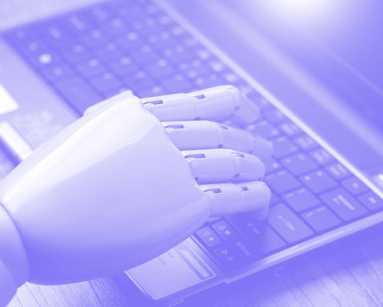 artificial intelligence hand type on keyboard