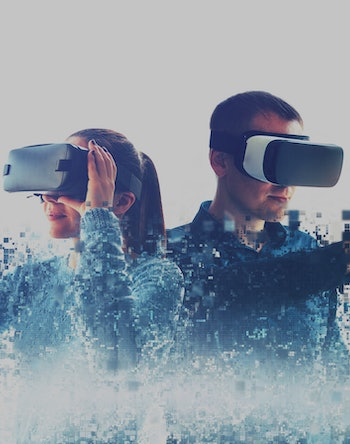 A man and a woman in glasses of virtual reality. The concept of modern technologies and technologies of the future. Fragmented by pixels. VR glasses.