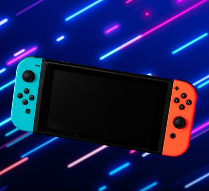 Photo of blue and orange video game console. Nintendo Switch. Android. How to hack Nintendo Switch. ...