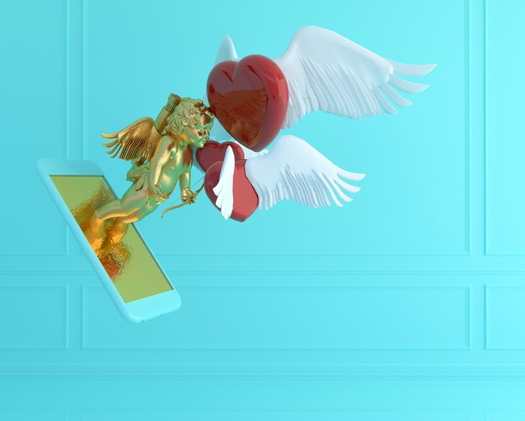 A golden Cupid emerges from the screen of a smartphone. There is a flying red heart with white wings by the Cupid's face. The background is aquatic green.