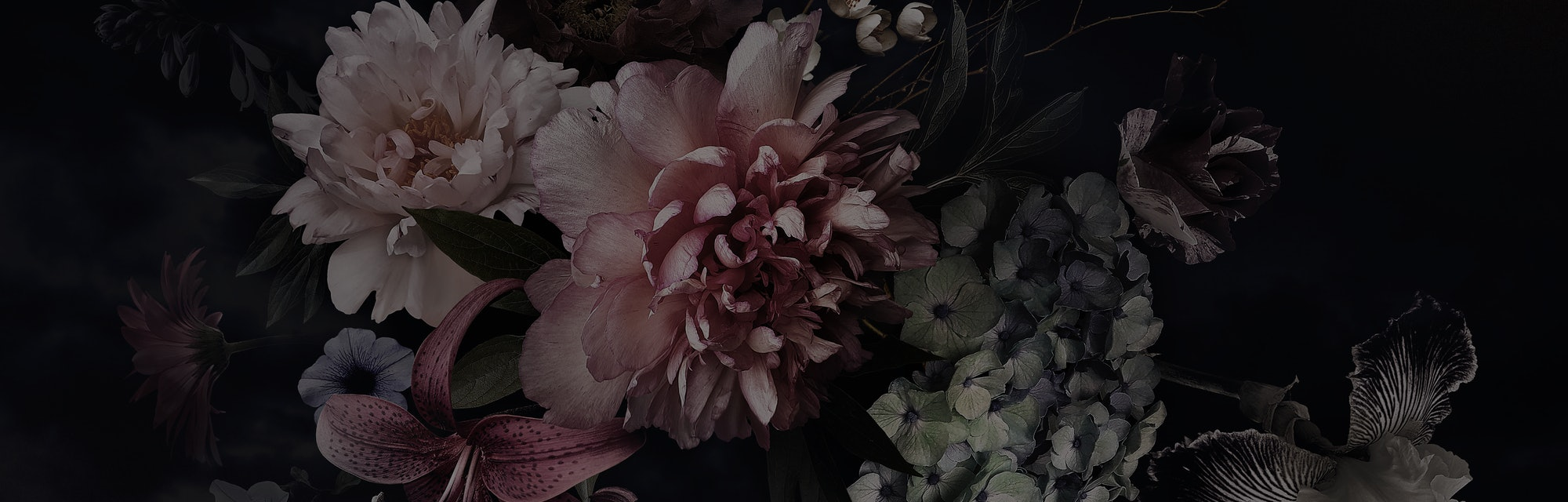 A bunch of peonies, tulips, lily, and hydrangea can be seen in front of a black background. The style appears to be Baroque in execution.