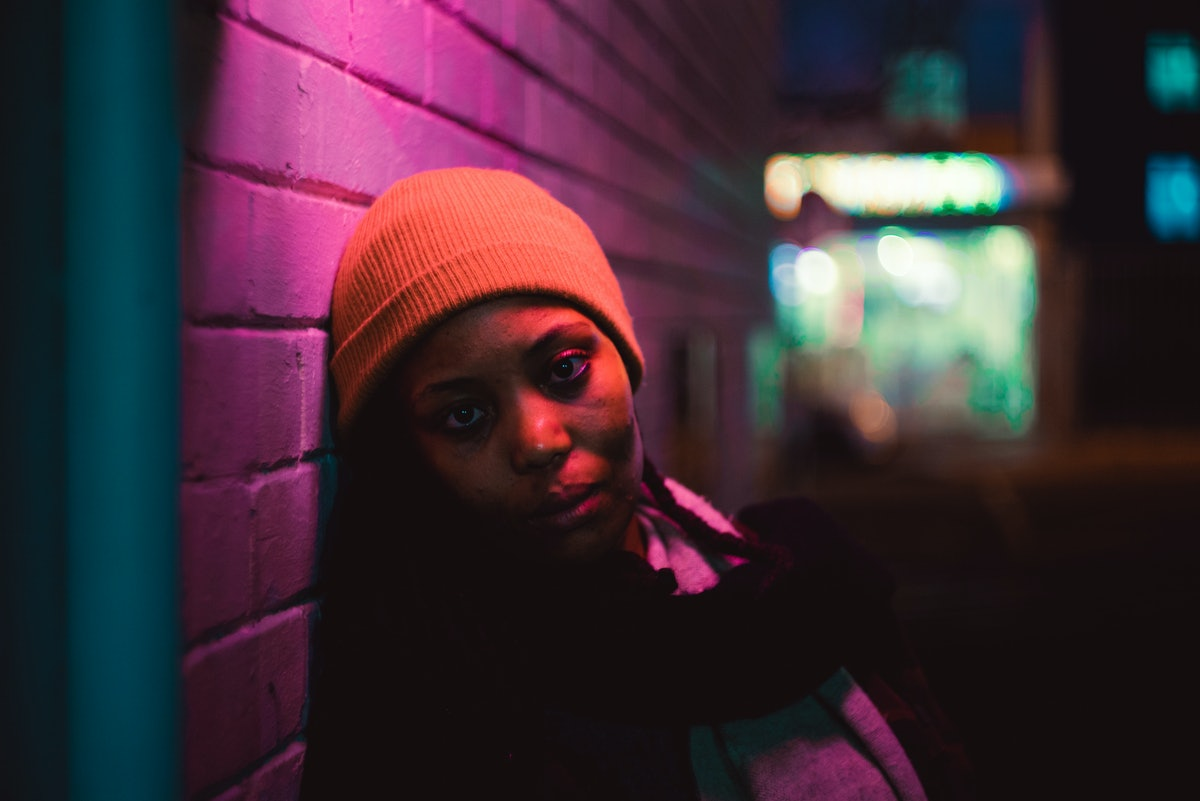 Portraits of a young black lady under colourful light