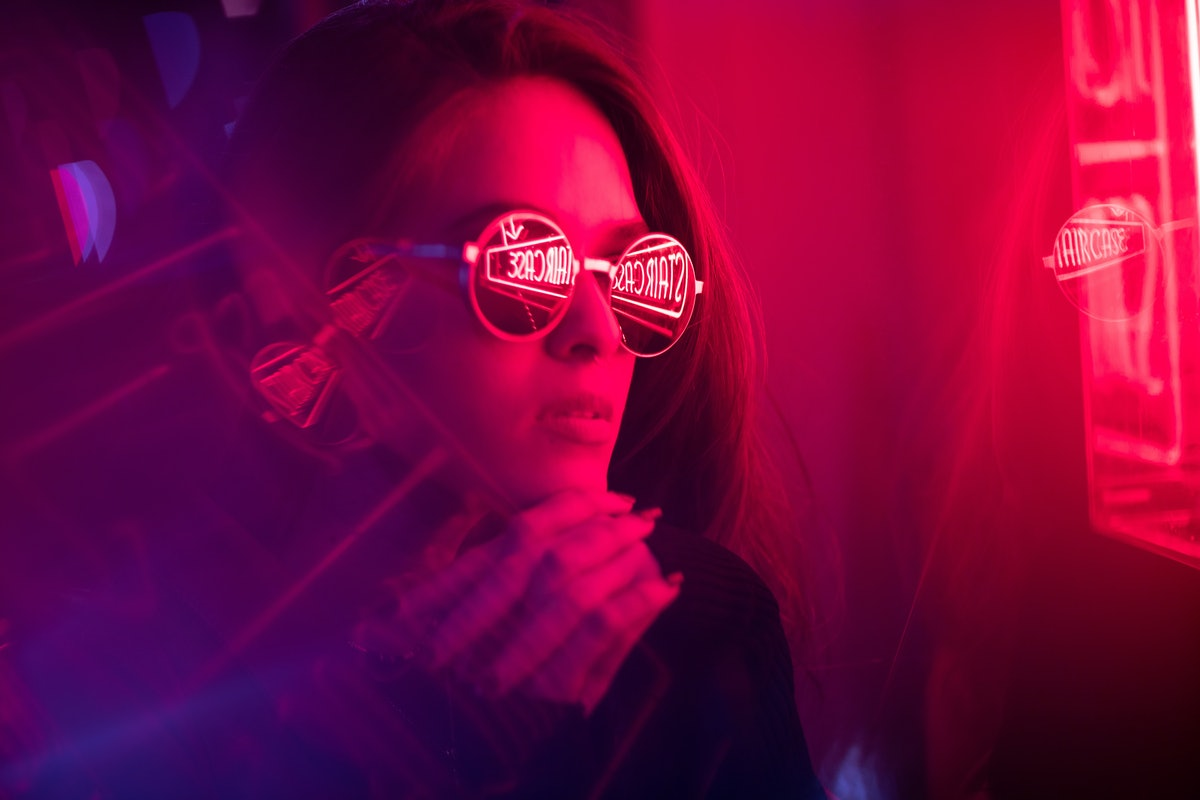 Cinematic night portrait of girl and neon lights