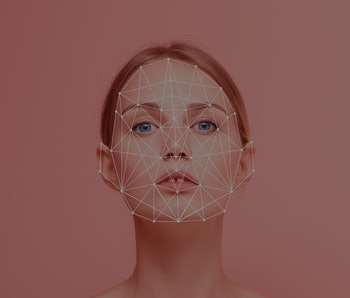 Facial recognition security system. Face augment mobile phone technology concept. Woman portrait looking to camera with grid on her face.
