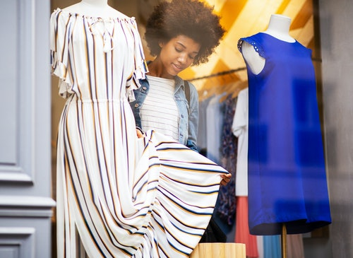 Portrait beautiful young african american woman shopping for clothes in store