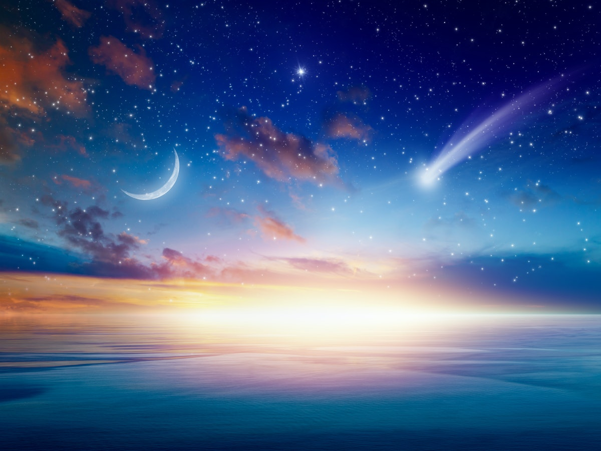Amazing heavenly background - beautiful glowing sunset with falling comet - mystical sign in sky, rising crescent moon and stars. Elements of this image furnished by NASA