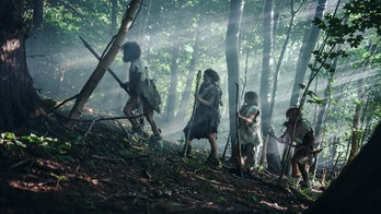 Tribe of Hunter-Gatherers Wearing Animal Skin Holding Stone Tipped Tools, Explore Prehistoric Forest...