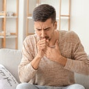 Coughing young man at home