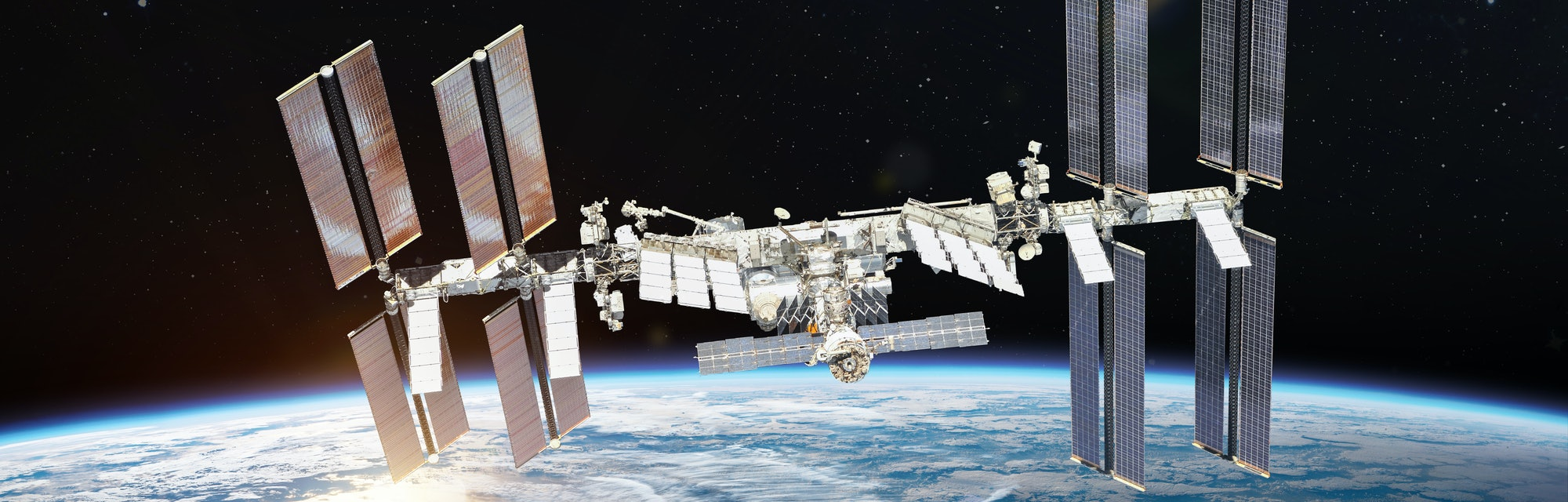 International space station on orbit of Earth planet. ISS. Dark background. Sun reflection. Elements of this image furnished by NASA