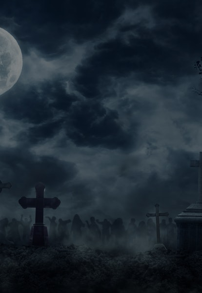 Zombie Rising Out Of A Graveyard cemetery In Spooky dark Night full moon. Holiday event halloween ba...