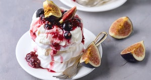 Mini Pavlova Cake with Figs and Berry Tasty Dessert Pavlova on White Plate White Cup of Tea and Whit...