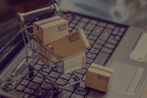 Online shopping / e-commerce and customer experience concept : Boxes with shopping cart on a laptop ...
