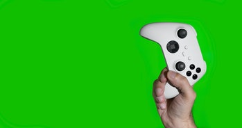Man holding next generation controllers