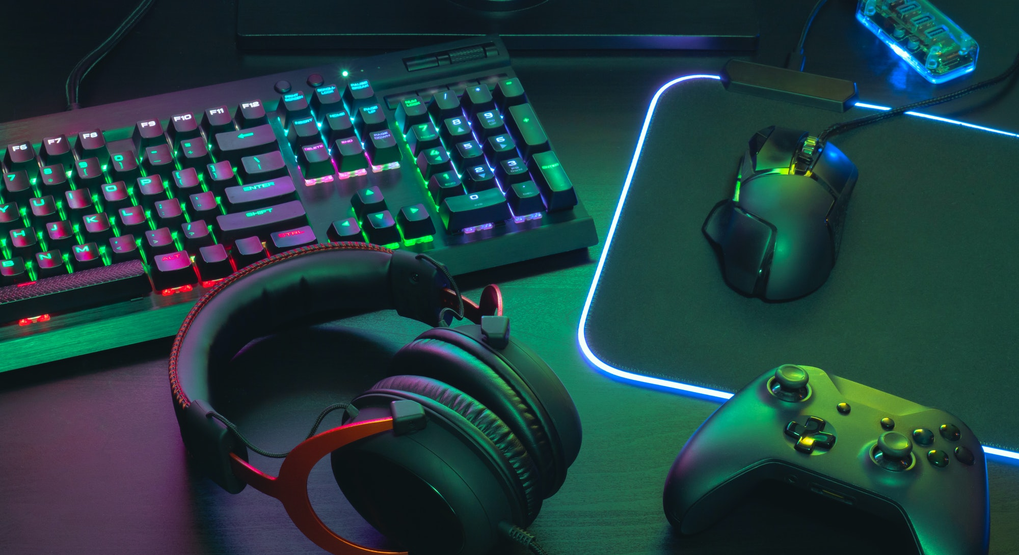 gamer work space concept, top view a gaming gear, mouse, keyboard, joystick, headset, mobile joystic...