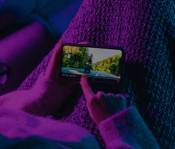 Woman stop watching film on mobile phone with imaginary video player service. Concept of online video streaming movies and series.