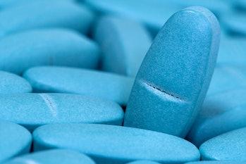 Medical blue pills macro background. Medicine concept of viagra, medication for stomach, erection, s...