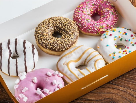 glazed donuts with different fillings in the box