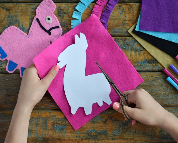 Making pink lama. Sewing toys from felt with your own hands. DIY concept for children. Handmade craf...