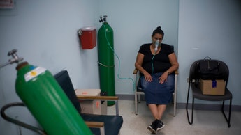 A woman affected by Hurricane Maria receives oxygen at the hospital in Catano, Puerto Rico