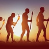 Concept of Darwin's theory of evolution, illustrated with the transformation of the human silhouette...