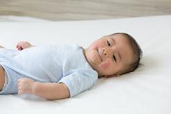 baby boy on bed with rash on cheeks