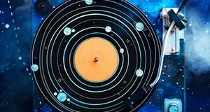 Creative music flat lay, vinyl record with solar system drawing and a galaxy hand. Astronomy concept