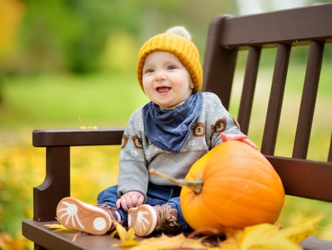 Thanksgiving outfits for boys can be cute, punny, and seasonal.