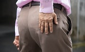old Asian man suffering from hip pain, pelvic dislocation, gout arthritis, osteoporosis, loss of bon...