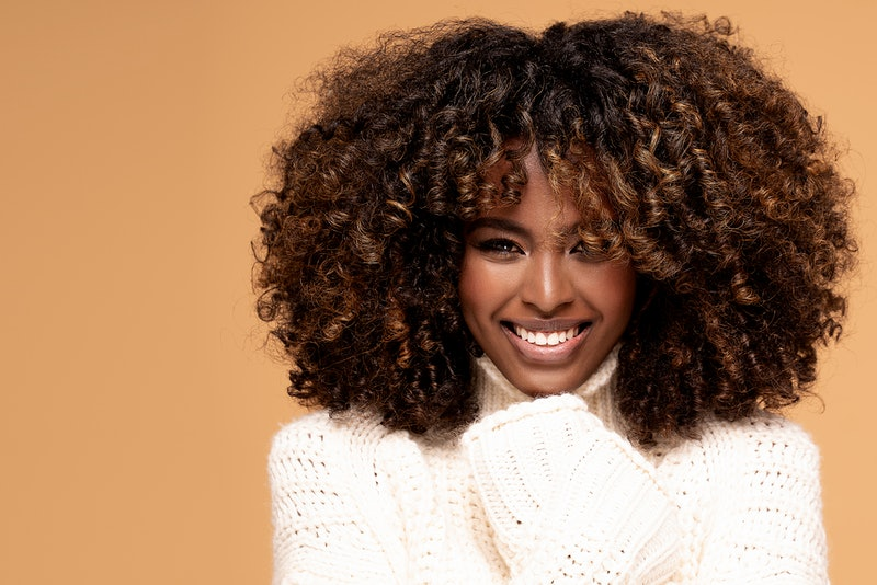 Experts explain everything you need to know about hair plopping for gorgeous curls.